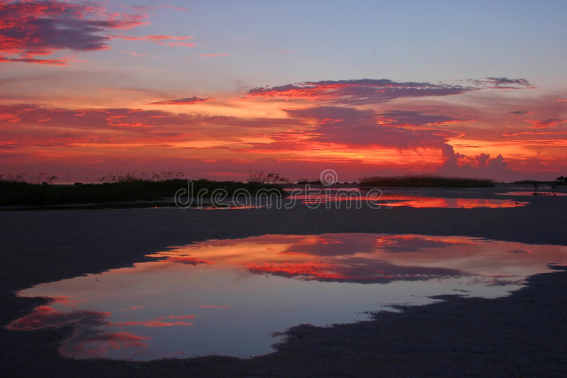Sunset reflections royalty free stock photography