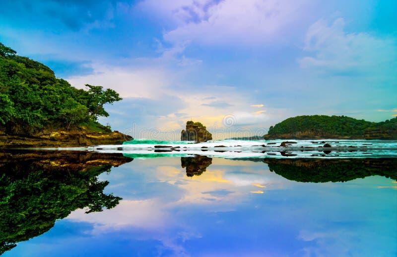 Sunset Reflections. Sky Reflections at Ngliyep Beach, Malang, Indonesia stock photo