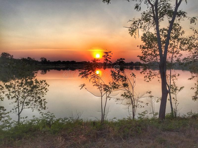 Sunset at the reservoir in the health park. royalty free stock image