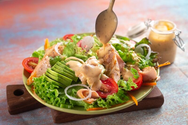 Fresh tasty salad with salmon royalty free stock photography