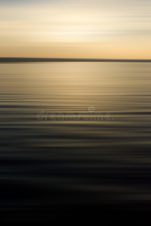 Sunset on rippled lake. Sunset on golden rippled lake and the horizon royalty free stock images