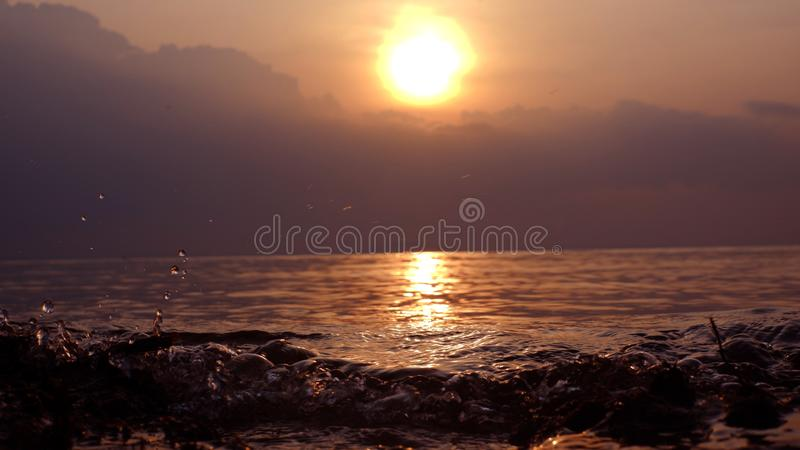 Sunset with rippling sea water royalty free stock photo