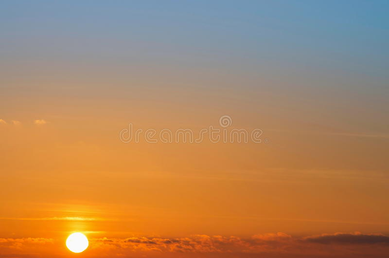 Sunset. The rising sun in the sky with clouds royalty free stock photography
