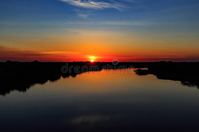 Sunset on the river with beautiful sky royalty free stock images