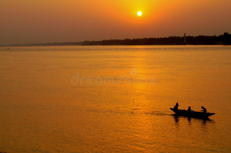 Sunset on a river. With a boat stock images
