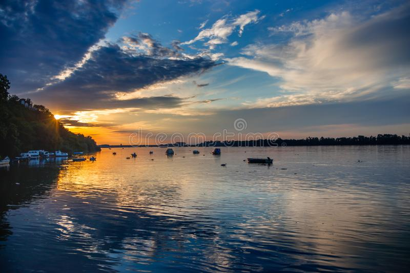 Sunset at river Danube, reflections and sunset on river Danube stock photos