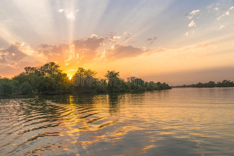 Sunset on the river. Gambia in tropical Africa royalty free stock photography