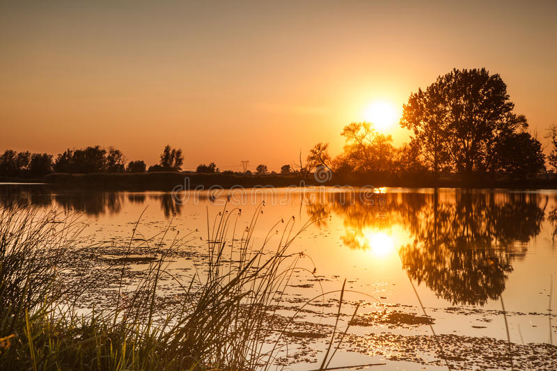 Sunset on the river. Landscape series stock image
