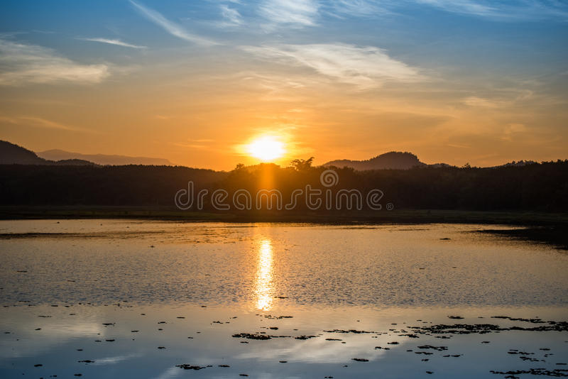 Sunset on river. And Mountain background stock images