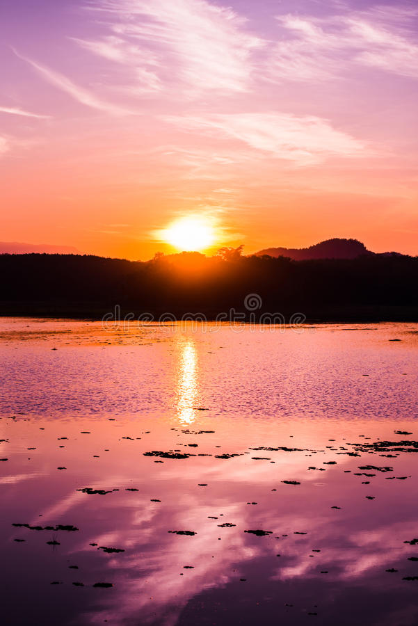 Sunset on river. And Mountain background royalty free stock image