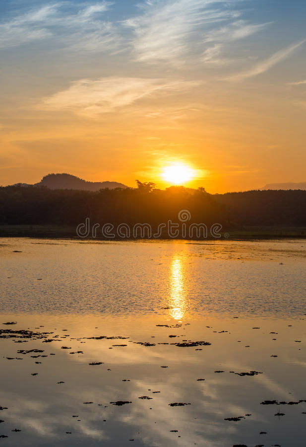 Sunset on river. And Mountain background stock photos
