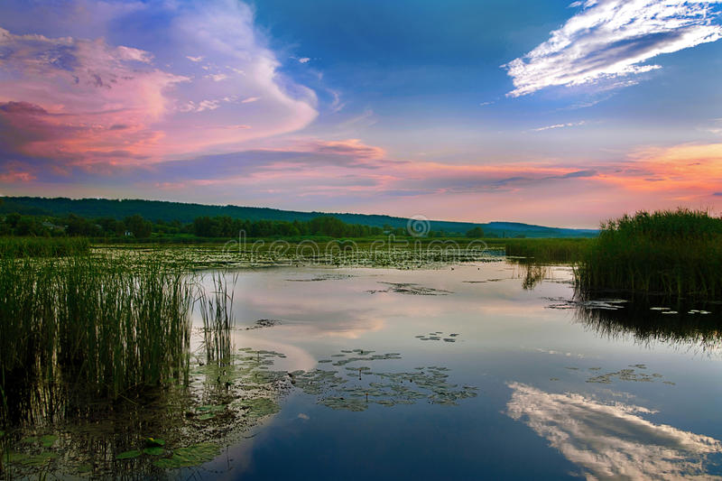 Sunset on river. Pink sunset with sky on river royalty free stock photography
