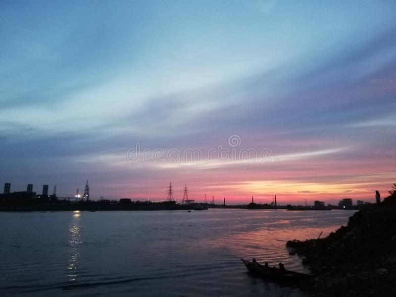 Sunset River Sky Blue Reflection. This picture is captured from Bosila, Dhaka. t contains natures with beauty of sunset stock image