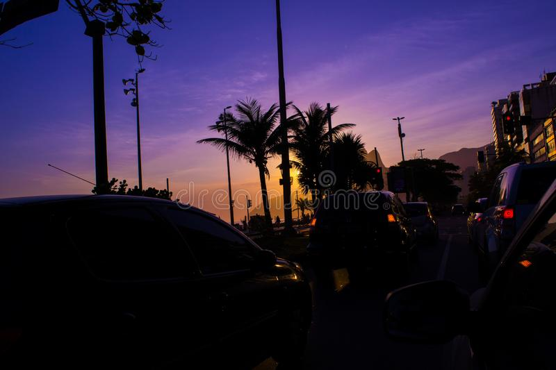 Sunset road with cars. stock photo