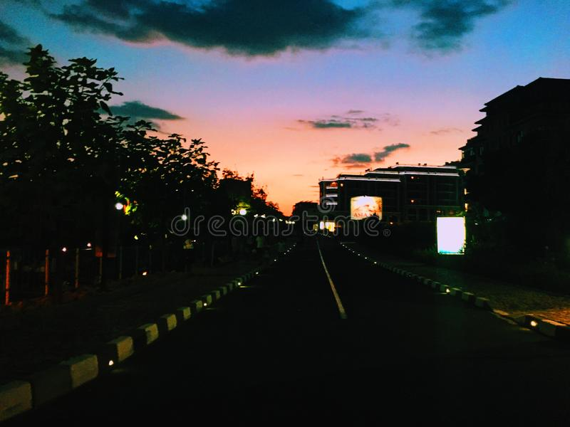 Sunset on the road in town. Processed with VSCO with k3 preset sunset road town stock image
