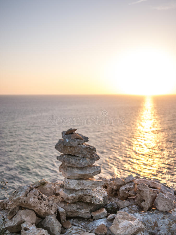 Sunset from the Rock. Stones in a pile in Formentera island, Spain stock image