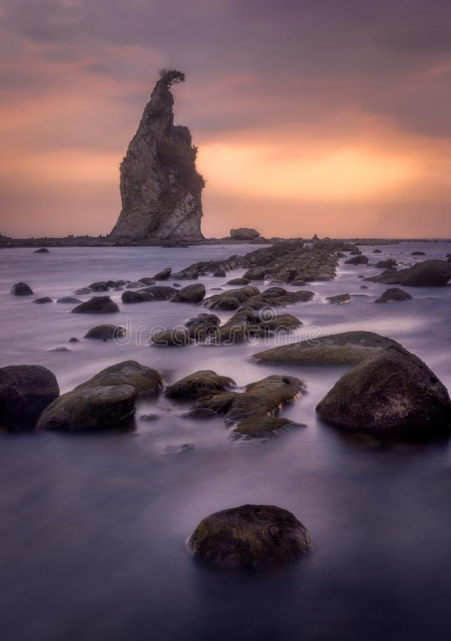 Sunset on the rocky beach. Sunset on the tanjung layar beach, Banten, Indonesia royalty free stock images