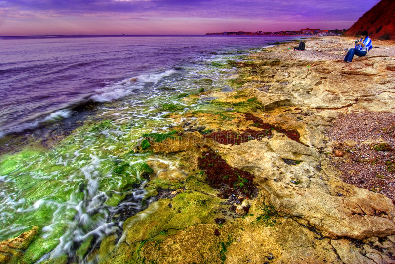 Download Sunset on rocky coastline stock image. Image of oceanfront - 3046825