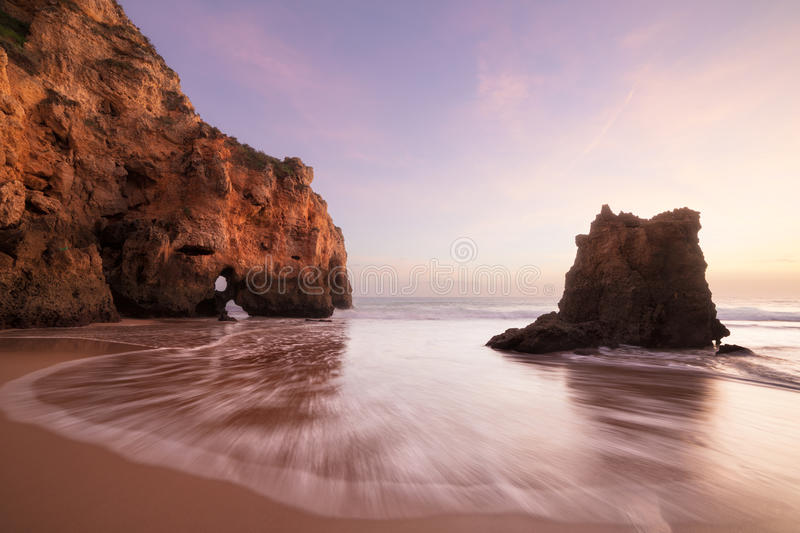 Sunset at rocky coastline of Atlantic ocean royalty free stock images