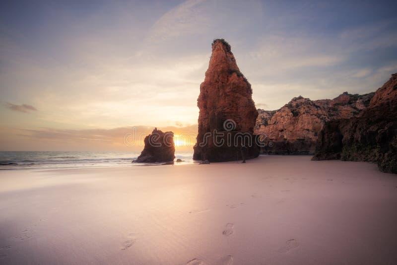 Sunset at rocky coastline of Atlantic ocean stock image