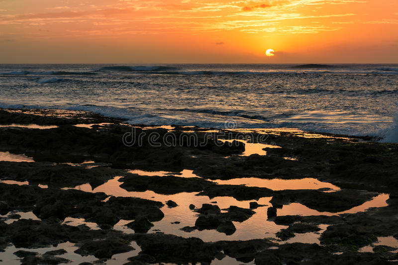 Sunset by rocky tide pools in Waianae, Hawaii. Sunset over tide pools in Waianae, Hawaii stock photography