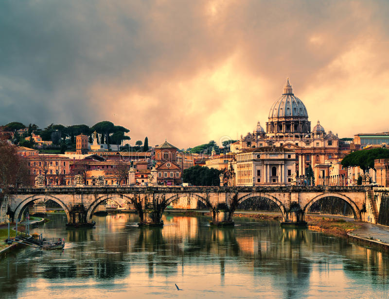 Sunset in Rome. View of the Vatican at sunset with bridges over the Tiber river in Rome, Italy. HDR image
