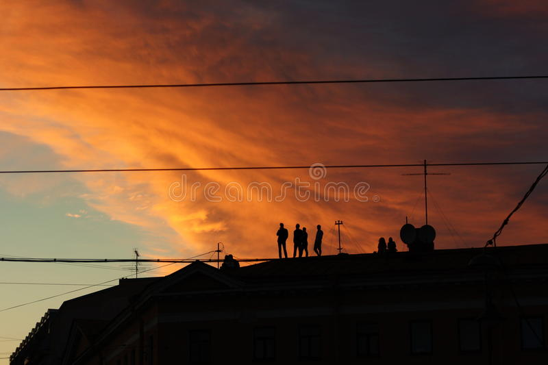 Sunset on the roof royalty free stock photo