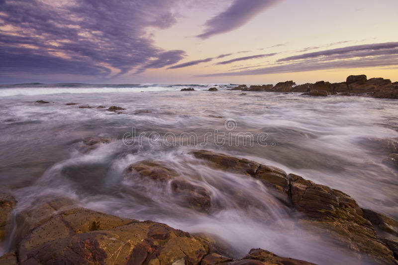 Sunset with rushing water royalty free stock images