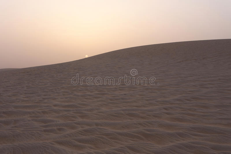 Sunset in the Sahara desert stock photography