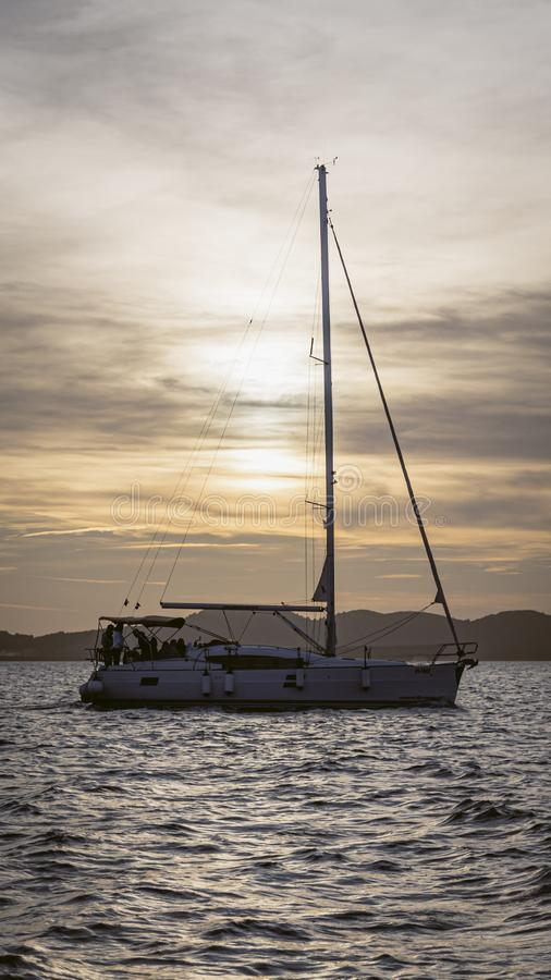 Sunset over a sail boat royalty free stock images