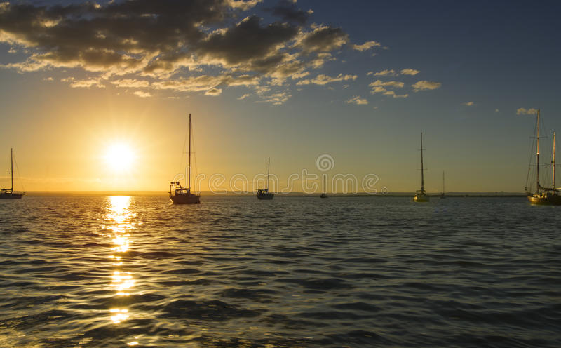 Sunset and sailboats La Paz harbor in Baja California Sur Mexico. The sun sets at the marina in La Paz Mexico royalty free stock photography