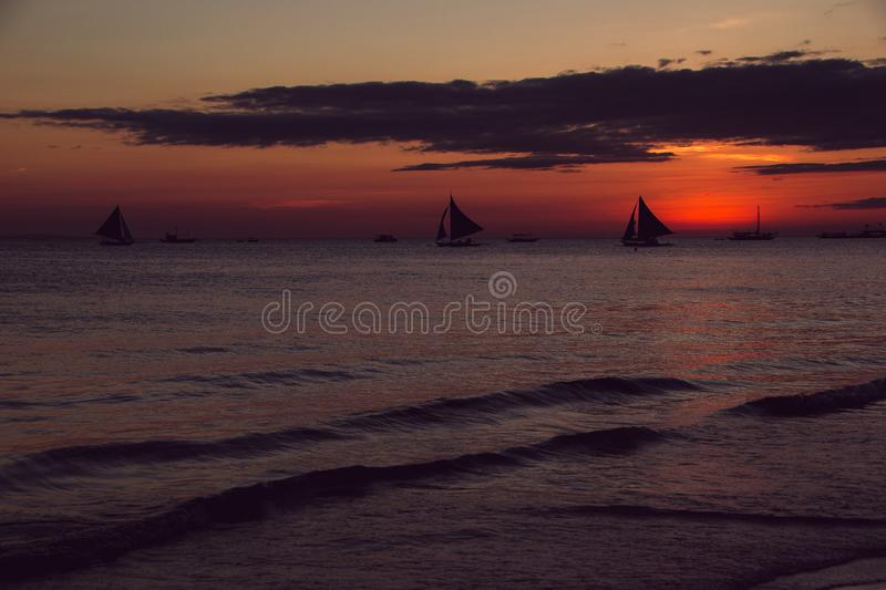 Sunset with sailboats. Summer time. Travel to Philippines. Luxury tropical vacation. Boracay paradise island. Nature background. royalty free stock image