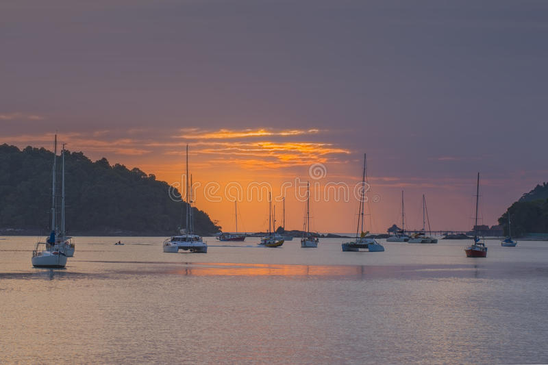 Sunset and sailing boats in the ocean at Langkawi, Malaysia royalty free stock photos