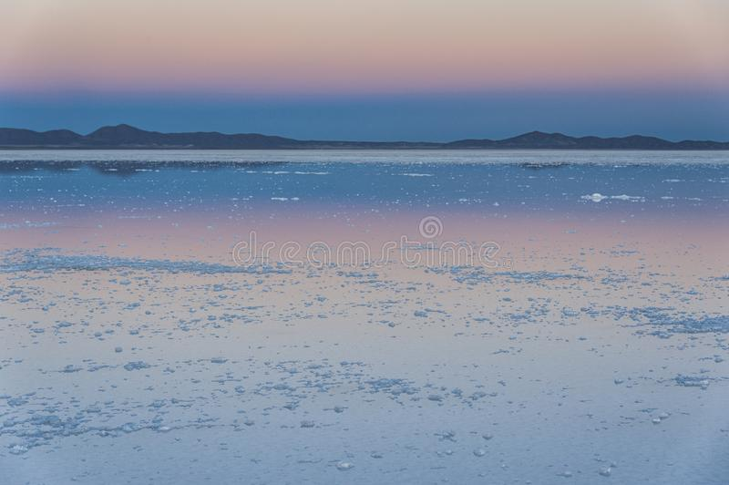 Sunset in the Salar de Uyuni near Colchani. It is the largest salt flat in the World UNESCO World Heritage Site - Bolivia royalty free stock photography