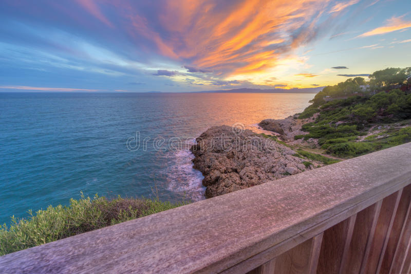Sunset in Salou - Spain. Sea Landscape from the top. At the golden hour in Far Salou, Province of Tarragona , Spain royalty free stock photos