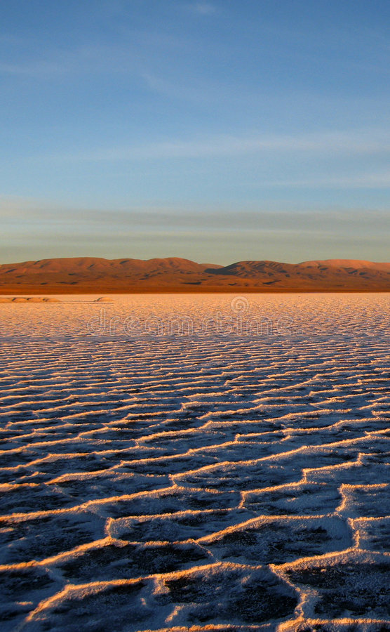 Sunset at salt flats royalty free stock photography