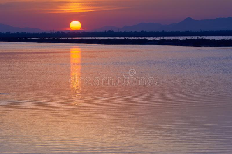Sunset in the salt flats. Of Santa Pola, an autumn afternoon. Clear orange tones and cool shadows illustrate this typographic image of the Spanish Levante stock images