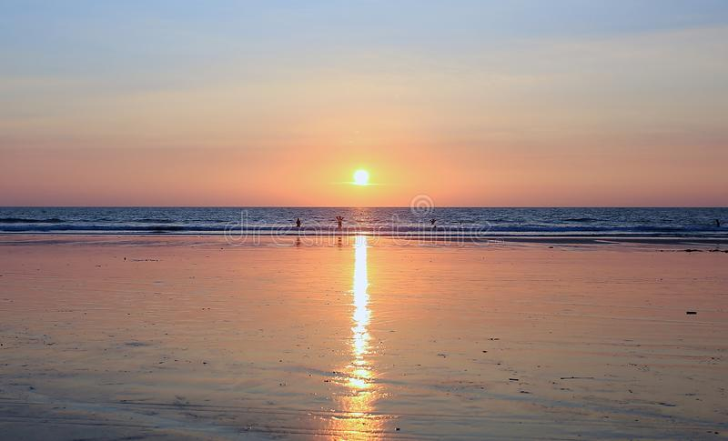 Sunset on the sand beach in India. Beautiful sunset on the sand beach inIndia royalty free stock images