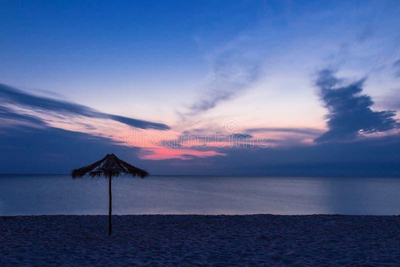 Sunset on a sand beach stock photography