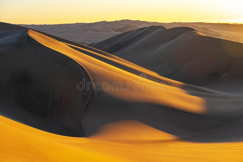 Sand Dunes Desert Sunset in Peru. Sunset in the sand dunes and desert between Ica and Huacachina, Peru, South America royalty free stock photo