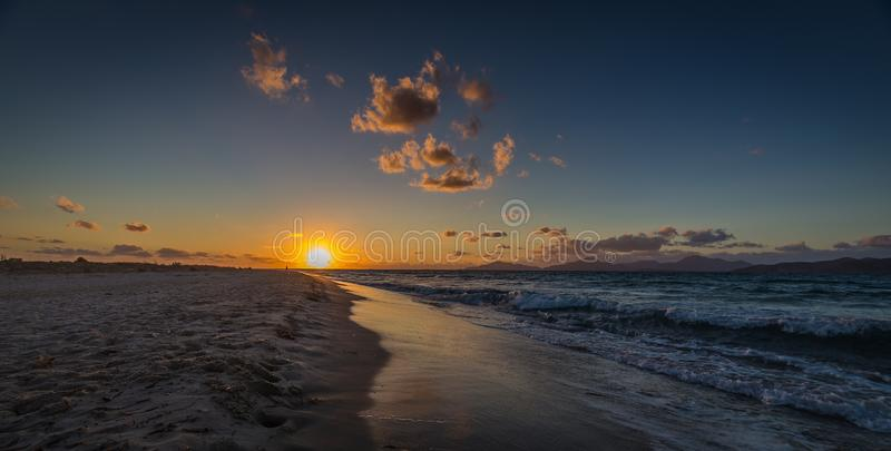 Sunset on sandy Alikes beach near Tigaki with dramatic cloudy sky royalty free stock photos