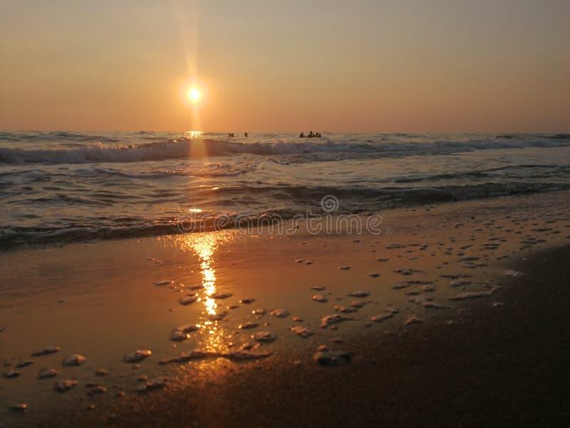 Sunset on sandy beach. A sunset on a sandy beach royalty free stock photo