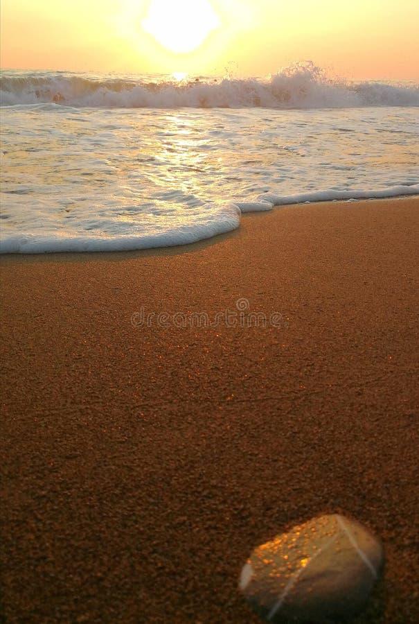 Sunset on sandy beach. A sunset on a sandy beach royalty free stock photography