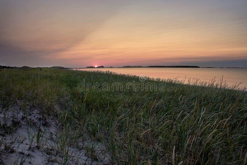 Sunset on the sandy beach Shallow Bay royalty free stock photos