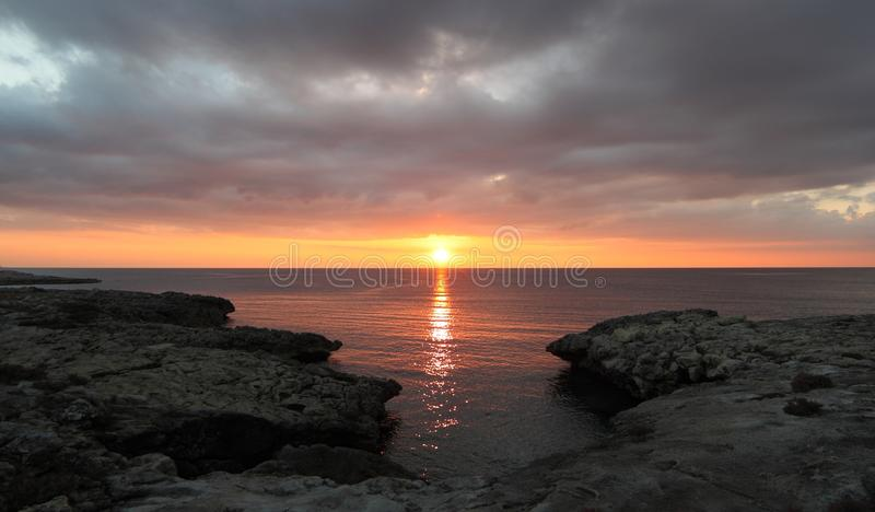 Sunset in Santa Caterina di Nardo in Italy. Sunset with great clouds on the cliff in Santa Caterina di Nardo in Italy stock photo
