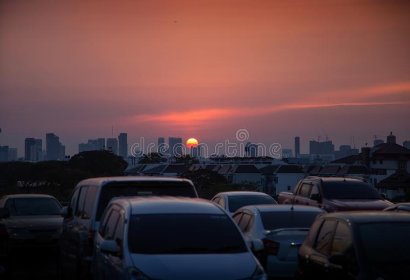 Sunset scence vehicle on city in sunset time. Parking area royalty free stock photo