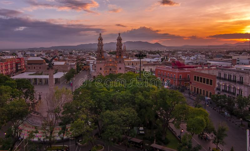 Sunset over downtown Aguascalientes, Mexico. Sunset scene in Aguascalientes downtown with colonial buildings and central plaza stock photo