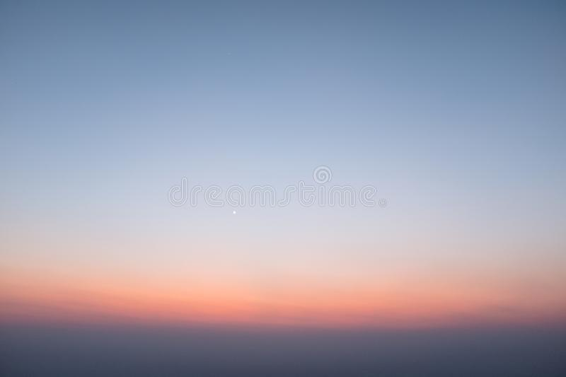 Sunset scene on hight mountain. Sunshine through the clouds. silhouette at the mountain. I. Sunset scene on hight mountain. Sunshine through the clouds stock photos