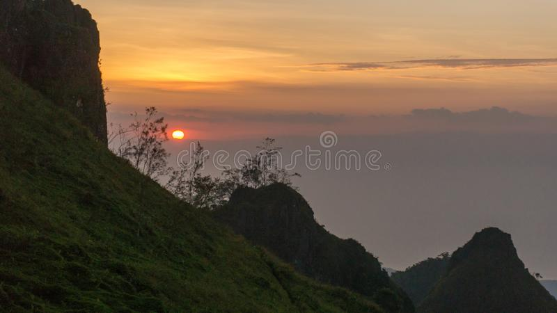 Sunset in the mountain peaks. royalty free stock image