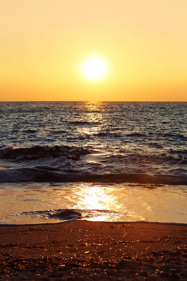 Sunset scenery at a beach in Paxos island Greece stock image